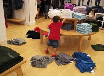 Some shitty little kid messing up a retail worker's hard work. Image via Facebook.