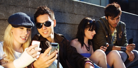 Just some regular Millennials hanging out with their cellular telephone devices. Image via Cal State Long Beach.
